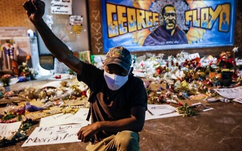 A protester at a memorial for George Floyd where he died outside Cup Foods in Minneapolis. Photo: AP Photo/John Minchillo