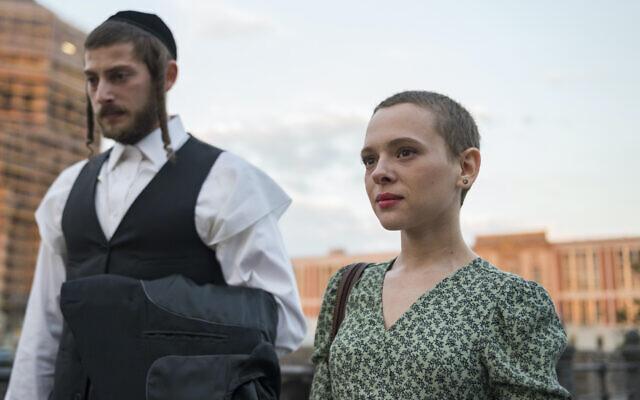 "Shira Haas, right, and Amit Rahav in ""Unorthodox."" (Netflix)"