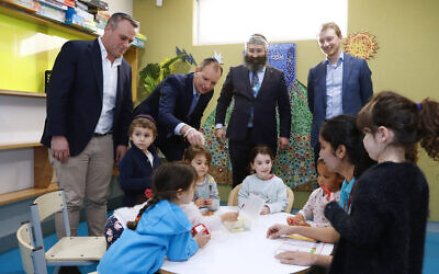 From left: Tim Wilson, David Southwick, Rabbi Motty Liberow and Senator James Paterson with children at Hamerkaz Shelanu's Lamdeni School after the security grants were announced. Photo: Peter Haskin