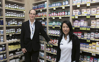 JewishCare executive officer Warren Hurst with Blooms Pharmacy manager Cary Huynh. Photo: Gareth Narunsky