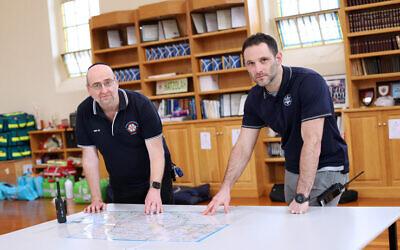 Leon Landau (left) of Hatzolah and Justin Kagan of CSG, at Hatzolah headquarters this week. Photo: Peter Haskin