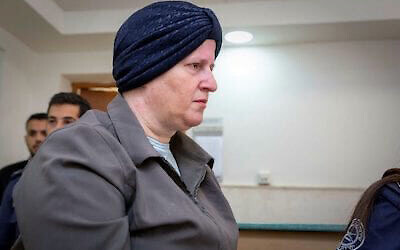 Malka Leifer is led out of the Jerusalem District Court in 2018.