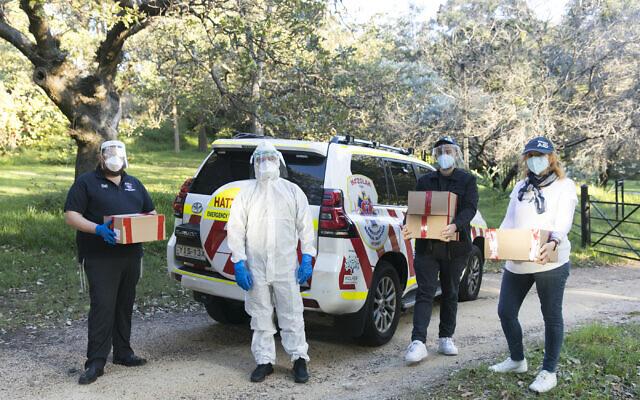 SmartAID volunteers delivering PPE to Hatzolah Sydney. Photo: Nadine Saacks