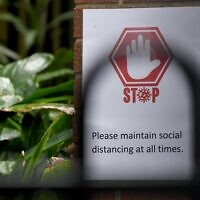 A COVID-19 warning sign at Rose Bay Public School last month. Photo: AAP Image