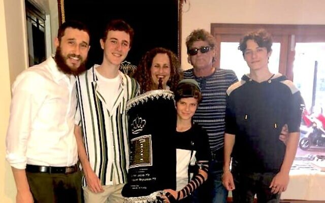 Rabbi Ari Rubin (left) with the Knezevick family.