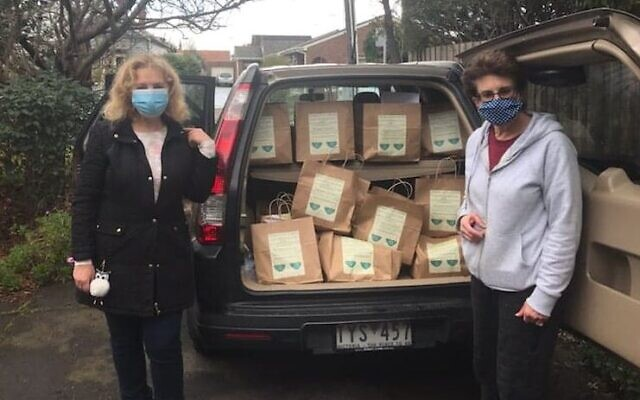 Ellen Frajman (right) with Mazon's soup share bags.