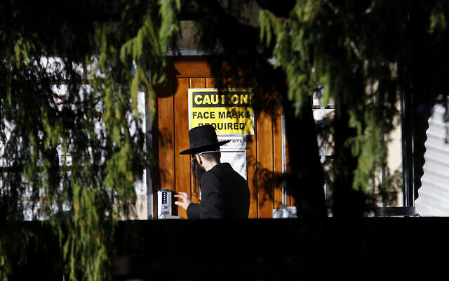 A member of the Satmar community arriving at his shule in Ripponlea this week.