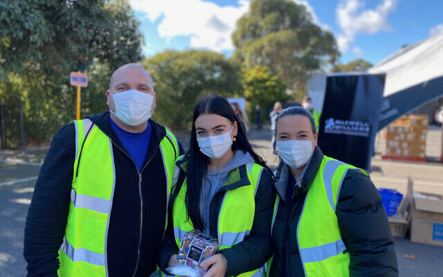 Tony Lotzof (left) at a collection point with daughter Amber (centre) and wife Toni.