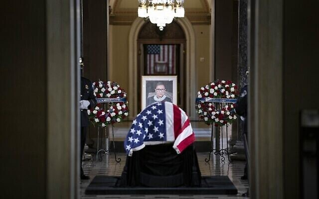 The casket of late Supreme Court Justice Ruth Bader Ginsburg is seen in Statuary Hall in the US Capitol to lie in state in Washington, DC, on September 25, 2020. (Photo by Sarah Silbiger / POOL / AFP)