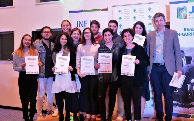 JNF CEO Dan Springer (right) with a group of Changemakers at last year's awards ceremony.
