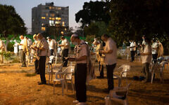 Israelis pray outside a synagogue ahead of Yom Kippur, the holiest day in the Jewish year, during a three-week nationwide lockdown to curb the spread of the coronavirus, in Tel Aviv, Israel, Sunday, Sept. 27, 2020. (AP Photo/Sebastian Scheiner)