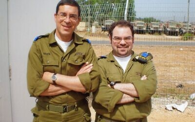 Mark Werner (left) and son David volunteering in Israel.