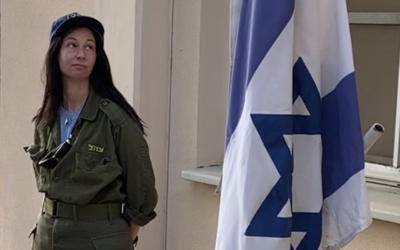 Tammy Graeve starting her day on an Israeli base with a flagraising ceremony.