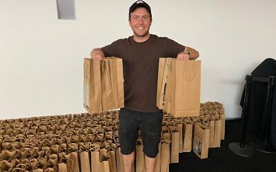 Volunteer Haim Ayalon shows off the High Holy Day packs.