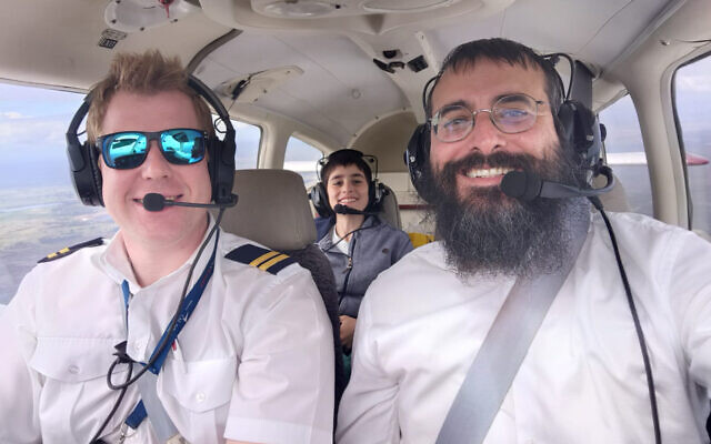 Rabbi Yehuda Niasoff (right) with instructor Sam Warriner (left) and son Avi (back).