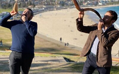 Rabbis Eli Schlanger and Yossi Friedman blowing shofars at Sydney's Bondi Beach in a previous year.