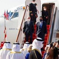 Head of Israel's National Security Council Meir Ben-Shabbat (L) and US Treasury Secretary Steve Mnuchin disembark from a plane upon their arrival at the Bahraini International Airport on October 18, 2020. - Israel and Bahrain will officially establish diplomatic relations at a ceremony in Manama, an Israeli official said, after the two states reached a US-brokered normalisation deal last month. (Photo by RONEN ZVULUN / POOL / AFP)