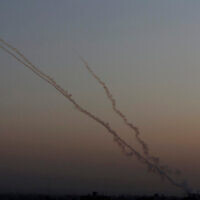 Rockets are launched from the Gaza Strip towards Israel, Wednesday, Nov. 13, 2019. Israeli airstrikes pounded Islamic Jihad group targets in Gaza and militants resumed rocket fire toward Israel after a brief overnight lull, raising the death toll to tens of Palestinians, including a 7-year-old boy and two other minors, in the heaviest round of fighting in months. (AP Photo/ Hatem Moussa)