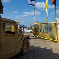 An Israeli soldier opens the gates of the Rosh Hanikra border crossing between Israel and Lebanon in northern Israel, Wednesday, Oct. 14, 2020. Lebanon and Israel began indirect talks Wednesday over their disputed maritime border, with American officials mediating the talks that both sides insist are purely technical and not a sign of any normalization of ties. (AP Photo/Ariel Schalit)
