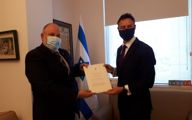 Paul Griffiths (right) presents copies of his credentials to Israeli Chief of State Protocol Meron Reuben.