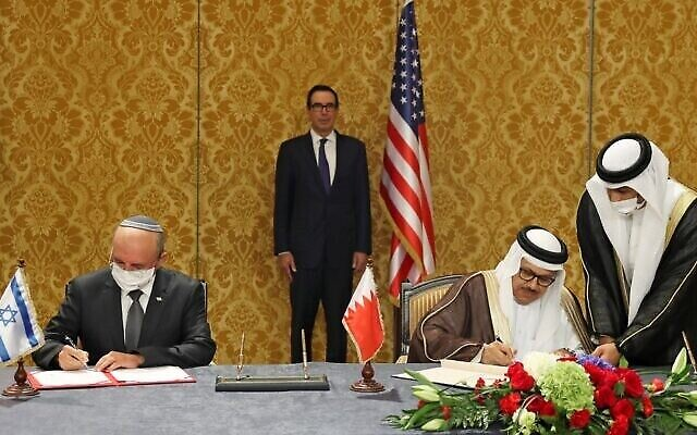 US Treasury Secretary Steve Mnuchin (C) attends a signing ceremony between the head of the Israeli delegation, National Security Advisor Meir Ben Shabbat (L) and Bahraini Foreign Minister Abdullatif bin Rashid Al-Zayani, in the Bahraini capital Manama, on October 18, 2020. - Israel and Bahrain formalised in Manama a US-brokered agreement they signed at the White House on September 15, officially establishing diplomatic relations. (Photo by RONEN ZVULUN / POOL / AFP)