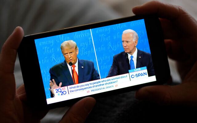 Watching last week's presidential debate on a smartphone. Photo: Dreamstime.com
