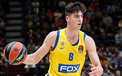 Maccabi Fox Tel Aviv's Deni Avdija controls the ball during the Euro League basketball match between Olimpia Milan and Maccabi Fox Tel Aviv, in Milan, Italy, Tuesday, Nov. 19, 2019. (AP Photo/Antonio Calanni)