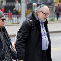 Convicted spy Jonathan Pollard and his wife, Esther, enter federal court in New York, Thursday, April 7, 2016. Pollard served 30 years for selling intelligence secrets to Israel. He is now on parole. (AP Photo/Mark Lennihan)