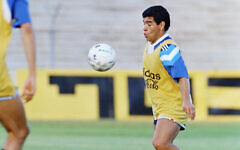 Argentinian soccer star Diego Maradona concentrates on receiving an incoming ball during the Argentinian national team practice held in Ramat Gan Stadium  Sunday, May 29, 1994. The Argentinian team customarily plays the Israeli national team in preparation for the World Cup finals. (AP Photo/Nati Harnik)