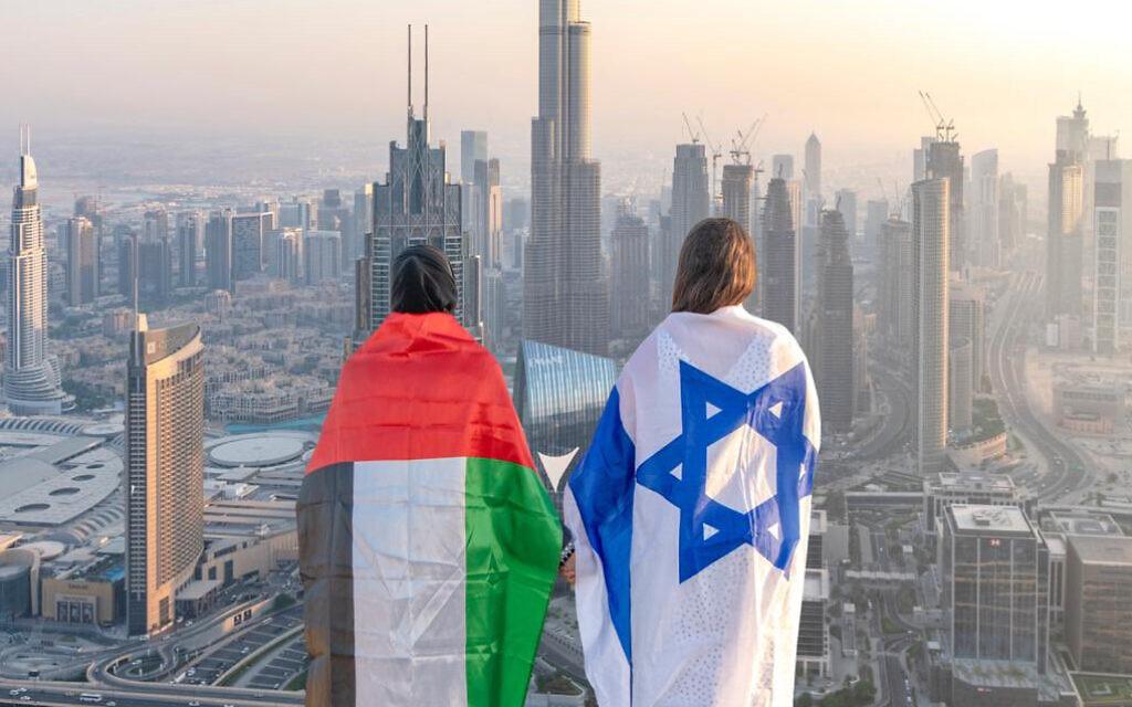 Emirati Norah al-Awadhi and her Israeli friend Ronny Gonen face Dubai's iconic Burj Khalifa, draped in their countries' flags to celebrate the Abraham Accords. Photo: Abdullah Sameh Houssny/@dubai.uae.dxb