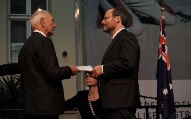 William Cooper's grandson Uncle Boydie (left) delivering a copy of his grandfather's protest letter following Kristallnacht to Dr Felix Klein of the German government in 2017.