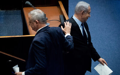 Israeli Prime Minister Benjamin Netanyahu and Blue and White party leader Benny Gantz at a memorial ceremony marking 24 years since the assassination of former israeli Prime Minister Yitzhak Rabin, in the Israeli parliament on November 10, 2019. Photo by Yonatan Sindel/Flash90