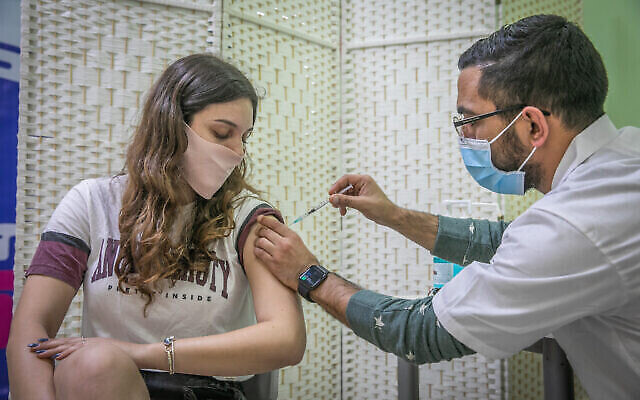 A woman receives a Covid-19 vaccine, at Clalit Covid-19 vaccination center in Rehovot, on January 4, 2021.  Photo by Yossi Aloni/Flash90