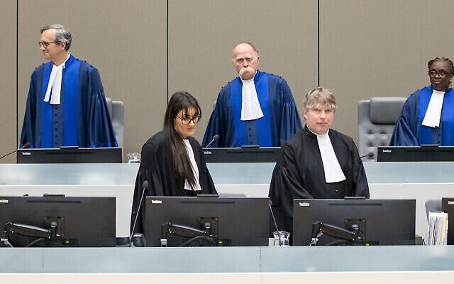 The Pre-Trial Chamber of the International Criminal Court, composed of (back row from left) Presiding Judge Marc de Brichambaut, Judge Peter Kovacs and Judge Reine Alapini-Gansou. Photo: Courtesy ICC
