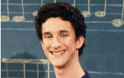"This image released by NBC shows actor Dustin Diamond as Samuel Powers, better known as Screech"" from the 1990's series ""Saved by the Bell."" Diamond died Monday after a three-week fight with carcinoma, according to his representative. He was 44. Diamond was hospitalized last month in Florida and his team disclosed later he had cancer. (Paul Drinkwater/NBCU Photo Bank via AP)"