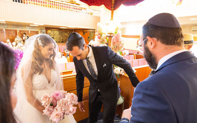 Carli Koonin and Justin Balbir with Rabbi Daniel Rabin.