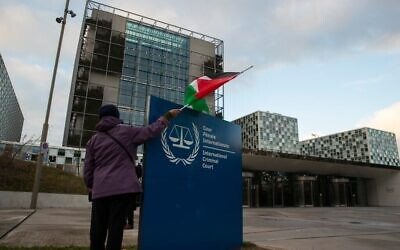 A demonstrator with a Palestinian flag outside the International Criminal Court in November 2019. Photo: AP photo/Peter Dejong