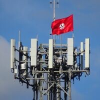 A Nazi flag attached to a phone tower in the the Victorian town of Kyabram last April. Photo: Twitter