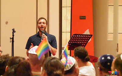 Jarod Rhine-Davis speaking at last year's Pride Shabbat event at Sydney's Emanuel Synagogue on Mardi Gras eve.