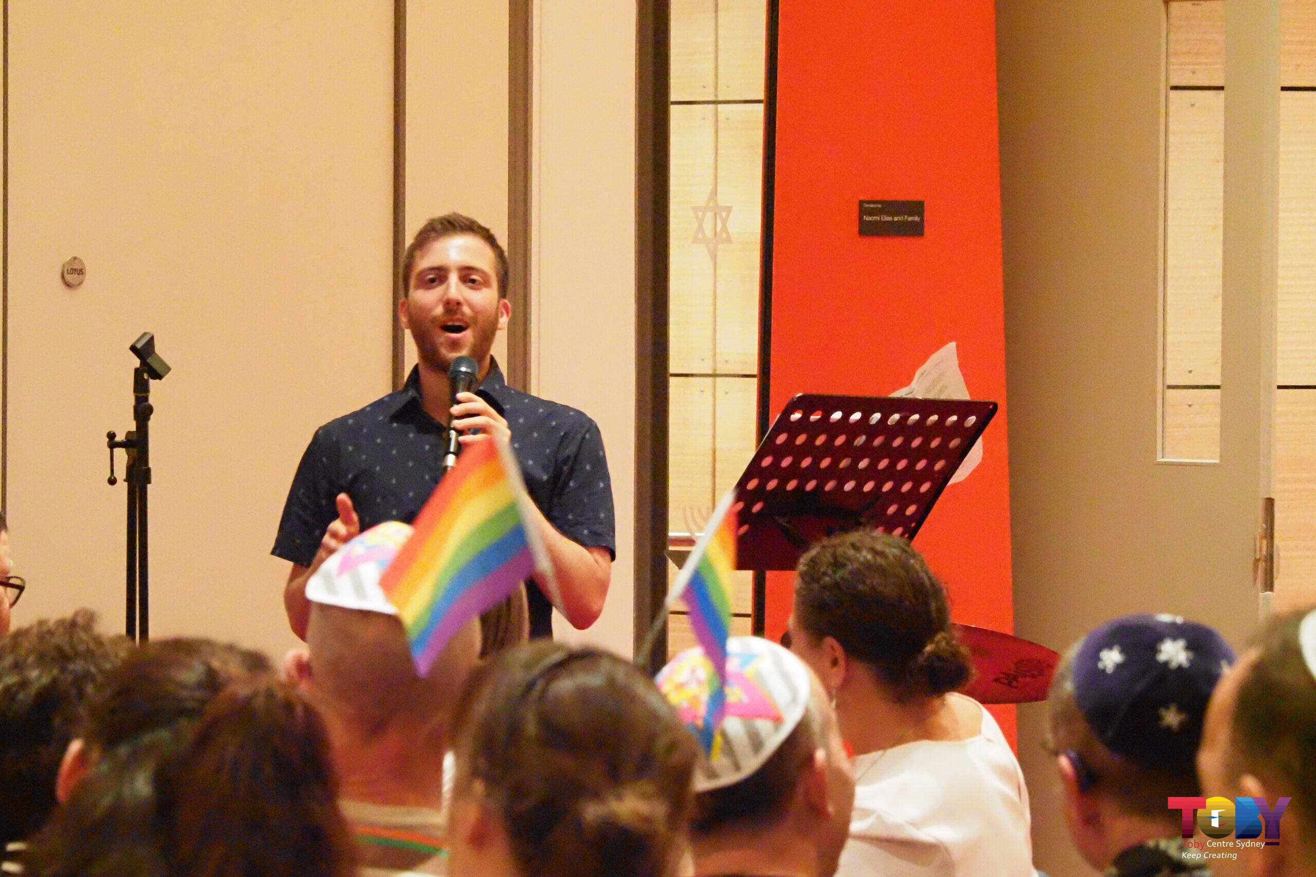 Jarod Rhine-Davis speaking at last year's Pride Shabbat event at Sydney's Emanuel Synagogue on Mardi Gras eve.