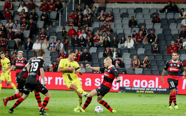 Tomer Hemed (in yellow) in action at Bankwest Stadium on Monday night. Photo: Shane Desiatnik