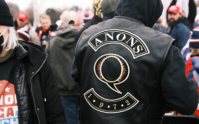 Patches promoting QAnon. Photo: Spencer Platt/Getty Images