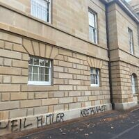 The graffiti scrawled on a wall of Parliament House in Tasmania last week.