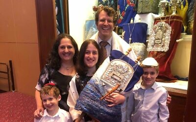 Daniel Aghion with his wife Jenny, sons Joseph and Ben, and daughter Michelle, preparing to celebrate Michelle's bat mitzvah at Temple Beth Israel.
