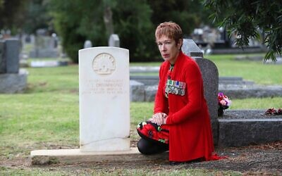 Sergeant Julie Leder, representative of VAJEX at the gravestone of James Drummond, who was in fact Jacob Sorsky. Photo: Peter Haskin