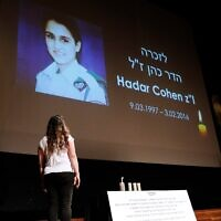 Orit Brand lights a candle for Hadar Cohen, an IDF soldier killed by terrorists in Jerusalem. Photo: Peter Haskin