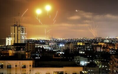 Rockets fired towards Israel from Gaza City, controlled by the Palestinian Islamist movement Hamas, are intercepted by Israel's Iron Dome Aerial Defence System on May 10, 2021. (Photo by MAHMUD HAMS / AFP)