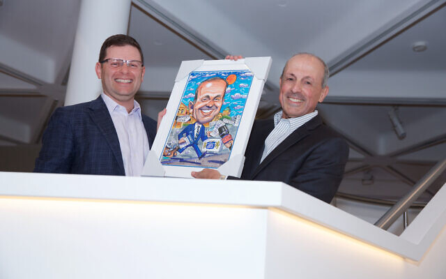 JBOD president Lesli Berger (left) presents a caricature to Alhadeff. Photo: Giselle Haber