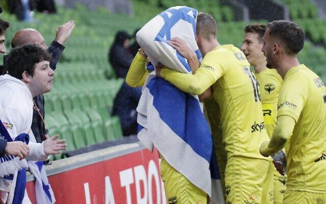 Wellington's Israeli striker Tomer Hemed celebrates a goal with Jewish fans at AAMI Park last Sunday. Photo: Peter Haskin