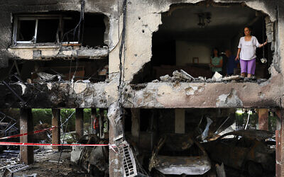 An apartment block hit by a rocket fired from the Gaza Strip in Petah Tikva. Photo: AP Photo/Oded Balilty